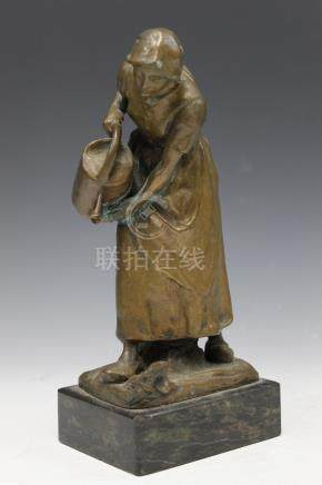Bronze statue of a lady watering flower.