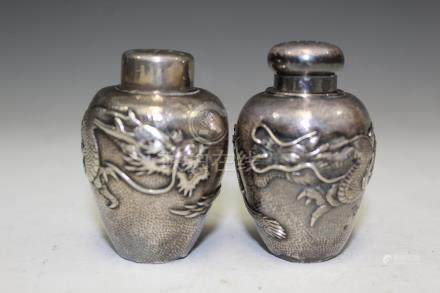 Pair of Japanese silver shakers.