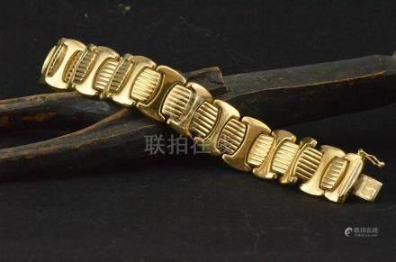 Bracelet plat articulé en or jaune 18 K P. 42,8 g L. 20 cm