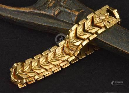 Bracelet articulé en or jaune 18 K P. 29 g L. 19.2 cm