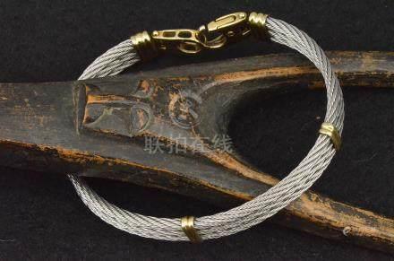 Bracelet FRED (force 10) en or et acier PB. 29,2 g Ø 6,5 cm environ L. 22 cm