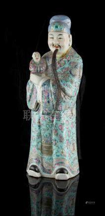 Property of a gentleman - a late 19th century Chinese famille rose figure of a mandarin holding a