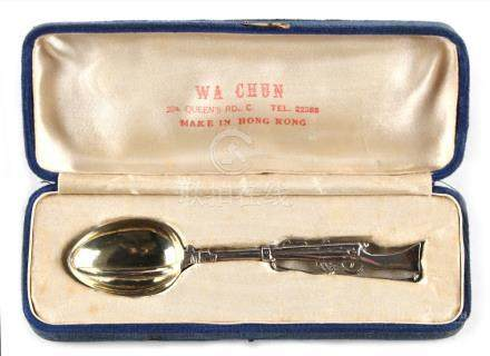 An early 20th century Chinese silver teaspoon modelled as a rifle with bayonet, makers Wa Chun, Hong