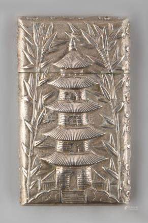 A late 19th / early 20th century Chinese silver card case, decorated in relief with a pagoda &