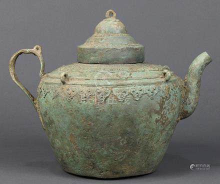 Vietnamese bronze ewer, Tran dynasty (14th c), with a tiered lid, the high shoulders of the vessel