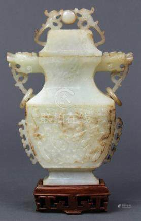 Chinese hardstone lidded urn, of flattened hu form with zoomorphic handles and loose rings, the body