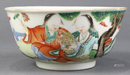 Chinese enameled porcelain bowl, featuring Hehe Erxian seated on a garden terrace, interior well