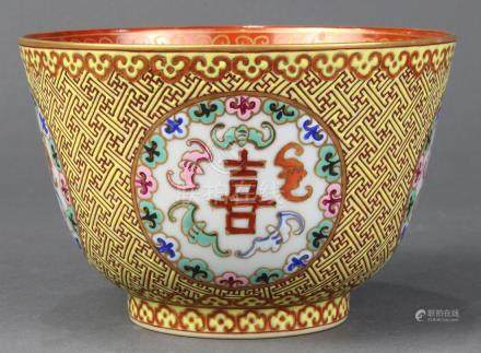 Chinese enameled porcelain bowl, the exterior with wanzi pattern on a yellow ground with reserves
