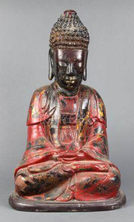 Vietnamese gilt red lacquered wood Buddha, with a tall ushnisha above the serene face, in monk's