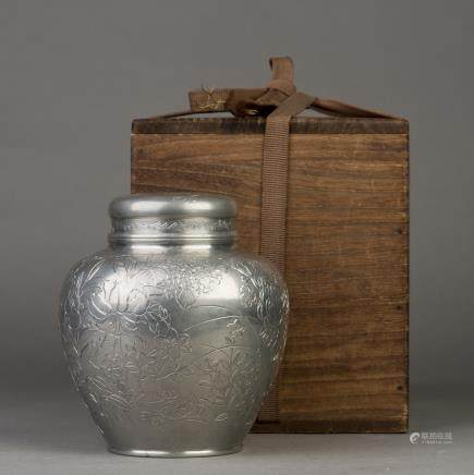 A SILVER CONTAINER FOR TEA