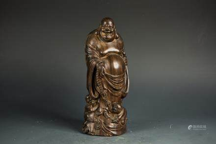 A HARDWOOD CARVED MODEL OF BUDAI