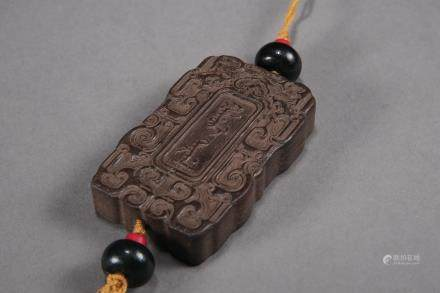 A Chinese Carved Agar-Wood Fasting Pendant