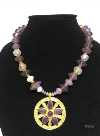 A PURPLE CRYSTAL INLAID 24K GOLD NECKLACE, GREEK