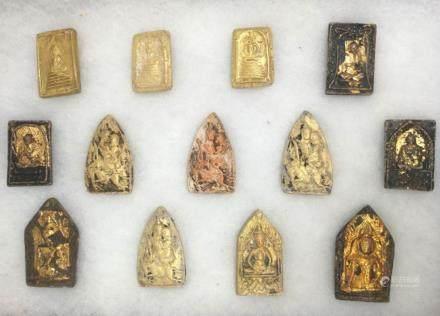THIRTY GILT MUD BUDDHA PLAQUES, TANG DYNASTY
