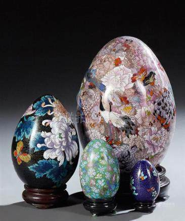 Group of Four Chinese Cloisonne Eggs, 20th c., on custom har