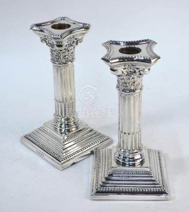 Pair of loaded silver Walker & Hall candlesticks