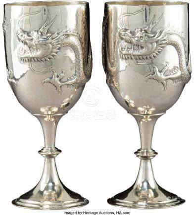 56025: A Pair of Asian Hammered Silver Dragon Goblets,