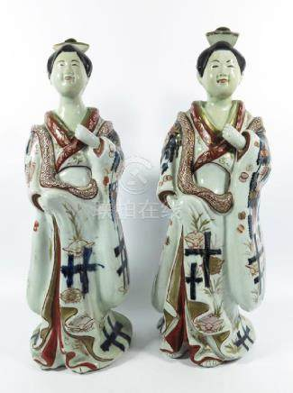 A large pair of Japanese Imari figures, modelled as