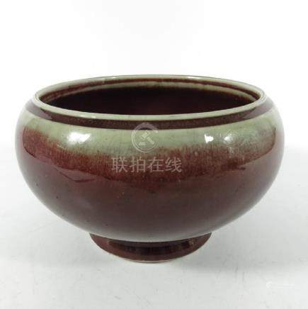 A Chinese flambe bowl, Qing, rounded footed form with