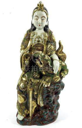 A large Japanese Satsuma figure of a deity with Shishi