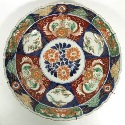 Three Oriental porcelain chargers, including two