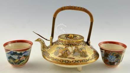 Japanese Satsuma compressed globular small tea pot, Meiji period, with figures on terraces, 14 cms