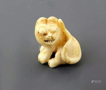 A Kyoto School style ivory netsuke of a seated tiger, unsigned, 19th CenturyPLEASE NOTE: THIS ITEM