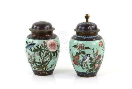 A Pair of Japanese cloisonné vases ; each one with domed cover and knop finial, decorated on the