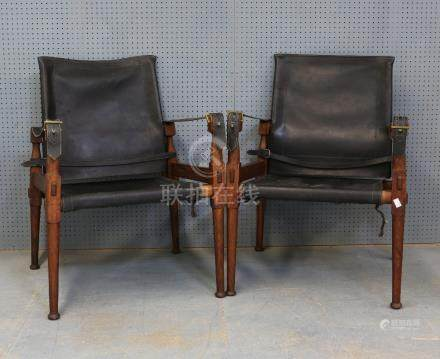 A Pair of Hayat & Bros. style, Indian hardwood and leather campaign chairs, the arms about 58 cm