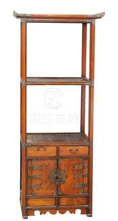 A Korean wood stand, designed with an arrangement of three shelves above a pair of hinged doors
