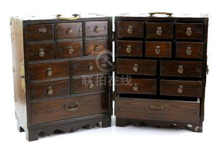 A Korean, or other Asian, hinged Chest opening to reveal a number of small drawers; with metal