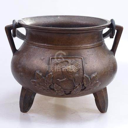 """An Oriental bronze cauldron with swing handle, height 7.25"""""""