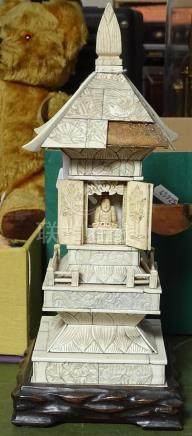 """An bone-clad wooden Buddhist shrine on carved wood stand, height 12.5"""" overall"""