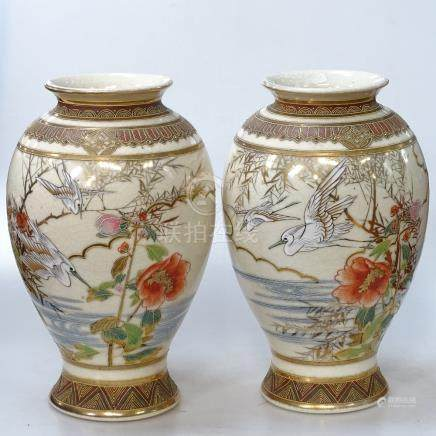 """A pair of Japanese Satsuma vases, with designs of cranes and blossoms, height 12"""""""
