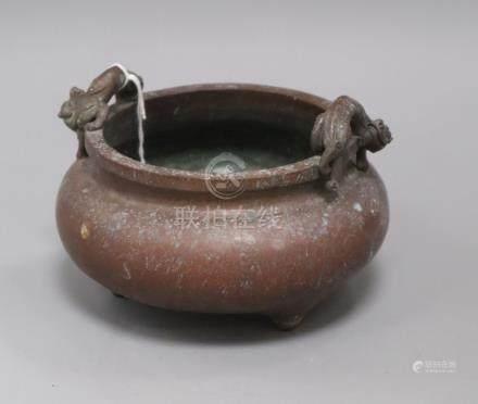A Chinese bronze tripod censer