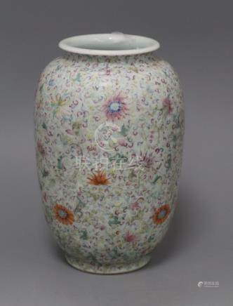 A Chinese famille rose ovoid vase, Qing dynasty, finely painted with flowers and scrolling