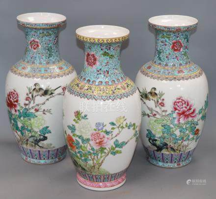 A pair of Chinese famille rose vases and another similar (3) Height 36cm