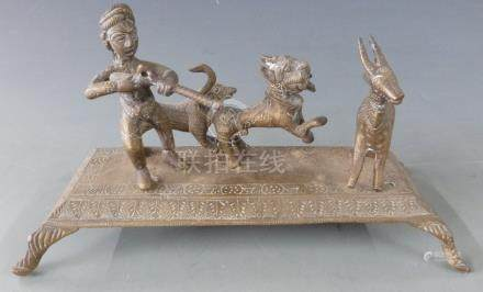 Eastern brass figural hunting group raised on footed base, H11cm, L23cm