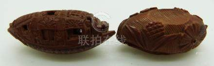 19thC Chinese peach stone carved as a junk with script to the base, together with another peach