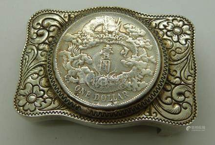 Chinese belt buckle in white metal floral and foliate design, coin to centre, pierced and signed