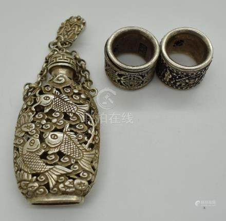 Chinese white metal snuff bottle on chain with four character mark to base and clip with fish and