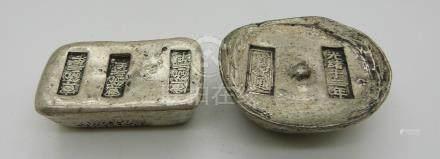 Two Chinese metal ingots/trade tokens
