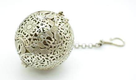 A pierced incense burner with bird decoration and suspension chain, the interior with gyroscope