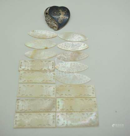 Sixteen mother of pearl gaming counters and a Siam niello brooch marked 925