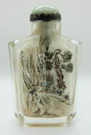 A Chinese reverse painted glass scent bottle with a jadeite cabochon to the stopper, 8.5cm tall