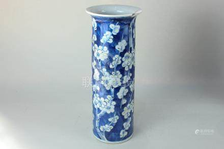 A Chinese porcelain blue and white cylinder vase with flared neck, decorated with prunus blossom,