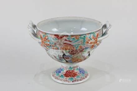 A Chinese porcelain two-handled pedestal bowl with polychrome decoration depicting peacocks and