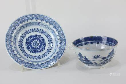 A Chinese porcelain blue and white circular dish decorated with floral and geometric borders, 16.2cm