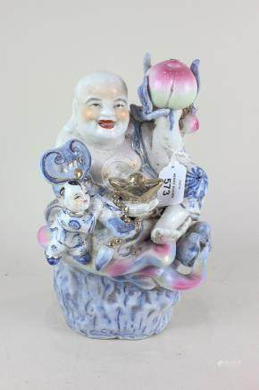A Chinese porcelain figure of a deity holding a peach, with gilt embellishments, 27cm, (a/f)