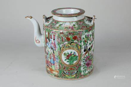 A Chinese Cantonese porcelain teapot and cover decorated with panels of figures, birds and